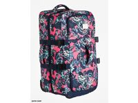 Brand new Large In the Clouds Roxy suitcase, still in packaging, pink/navy flower pattern