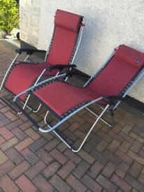 Two matching French Lufuma relaxation chairs