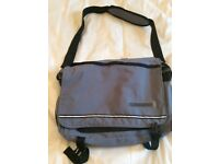Grey and black bag ideal for laptops with numerous zipped pockets and carrying strap