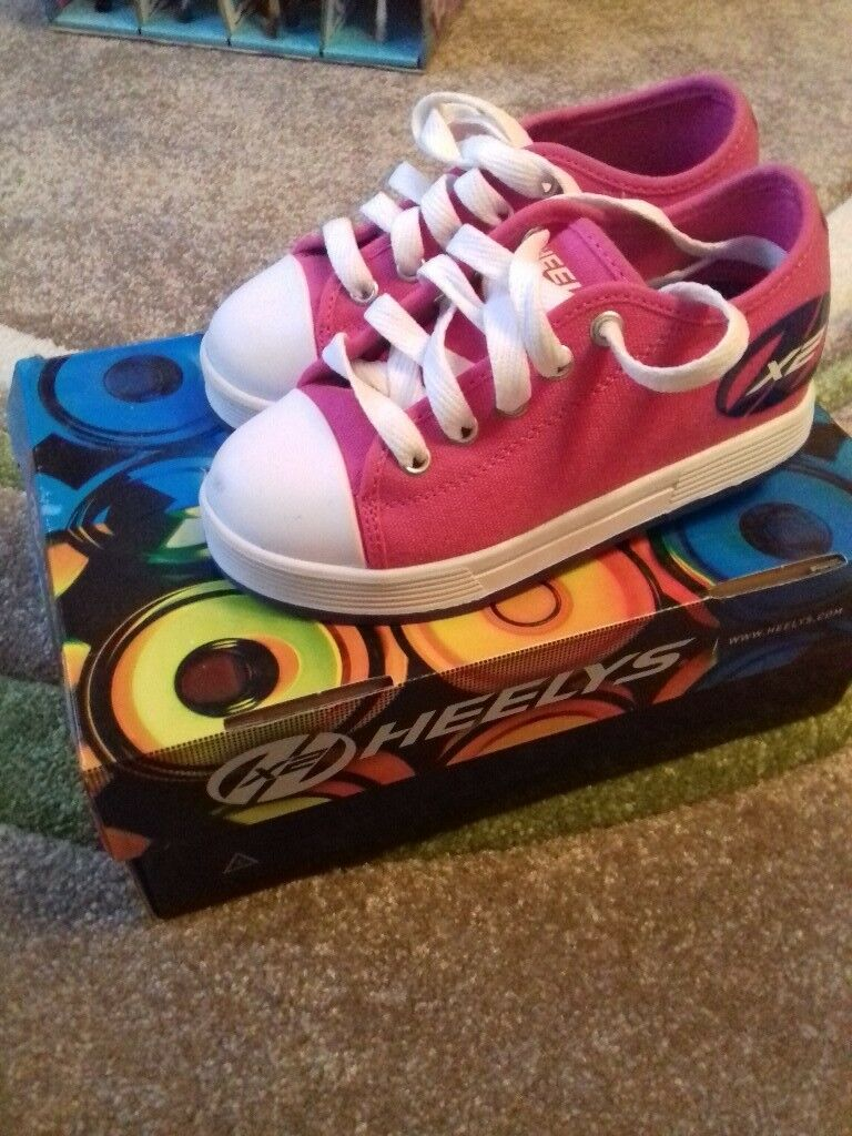 Size 12 Heelys, pink, really good condition, hardly used small mark on front left and mark on back.