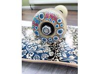 """Complete Skateboard - NEAR NEW (flower pattern 8"""" wide deck, heroin eye glow in the dark wheels)"""