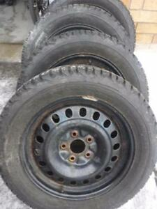 LIKE NEW CHEVY MALIBU FIRESTONE WINTER TIRES 225 / 55 / 17 ON STEEL RIMS.