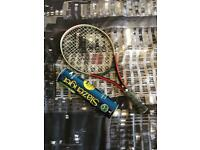 Tennis racket and two new tennis balls