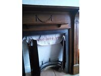 Cast iron fire surround with oak fire place