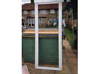 For sale a UPVC door complete with frame,. the glass is obscure,.