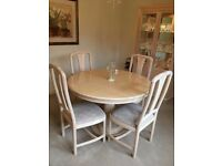 Dining table and 4 upholstered chairs in limed beech from Barker & Stonehouse.