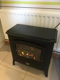Electric fire, real coal,different heat settings + very warm.