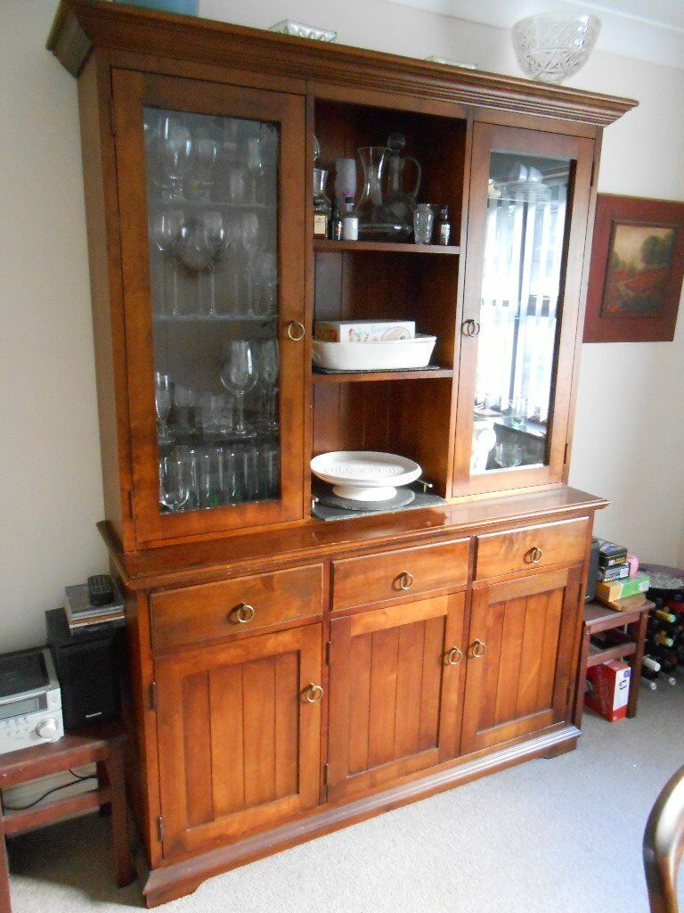 Dresser with illuminated glass cabinetsin Southampton, HampshireGumtree - Dresser with illuminated glass cabinets. The base has three large cupboards and three drawers. Each side of the top is a glass cabinet with a light hidden in the top. Three shelves sit between the two glass cabinets. The unit is in good condition,...