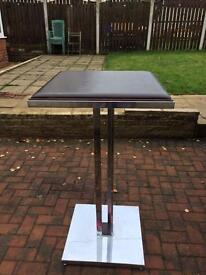 Brown and chrome table/stand can deliver