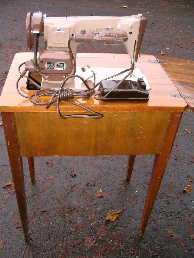 Singer sewing machine in cabinet table, electric, vintage laptop ...