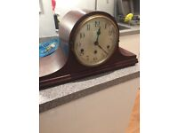 Old chiming clock in Napoleon hat style with Westminster chimes