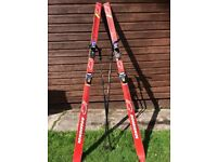 Pair of skis and poles . Rossignol c2 series .. material is fibreglass