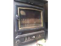 Wood or any solid fuel burner, has back boiler if hot water required