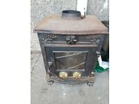 NOW SOLD .Wood burning stove - needs restored