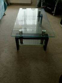Glass table mahogany legs