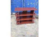 A 4 level bookshelf with end compartments