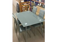 4 FT GREY GLASS TABLE AND 4 CHAIRS