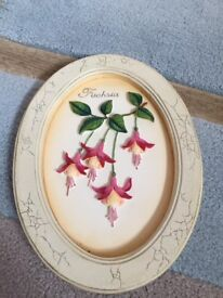2 Marks and Spencer flower wall plaques.