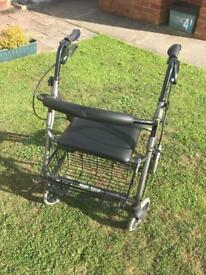 Disabled persons rollator with seat and basket