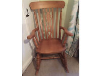 Solid wood rocking chair, showroom condition, lovely carving, as new, £75