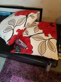 Two brand new cushions still with label on