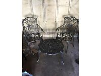 Pair of metal garden chairs and coffee table