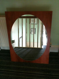 mirror with oval shaped glass