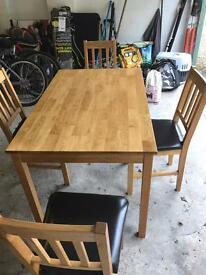 Solid wood table with 4 leather base chairs £100