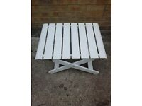 White plastic folding garden table