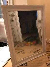 White wood framed mirror