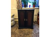 DVD/CD cabinet. Dark wood. Nice condition. Smoke free home.