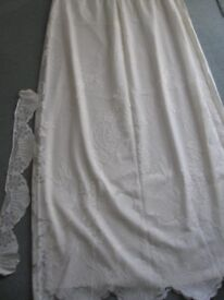 Cream lacy curtains and tie backs