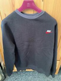 Nice black crew neck jumper with red nike tick