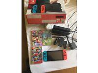 Nintendo Switch Neon + 3 games(BOTW,mario K&Odysessy)