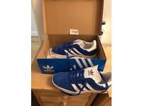 Blue Adidas gazelle.