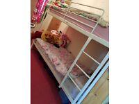 White metal bunk beds