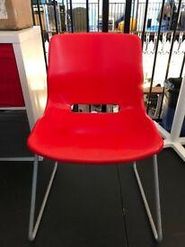 FREE - Three red plastic chairs