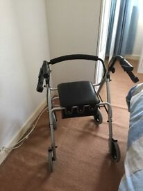 4 wheeled mobility walking frame with lift up seat