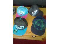 four designer caps