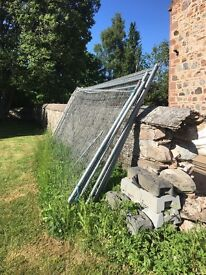 8 Heras fencing panels and 7 feet