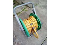 Excellent condition hose reel and hose pipe over 60ft in length, £15.00