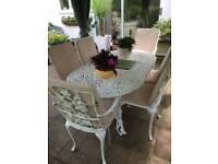 White Iron Garden/Patio furniture. Table + 6 chairs + cushions