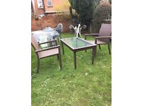 2 SEATER PLASTIC WICKER CHAIRS AND COFFEE TABLE