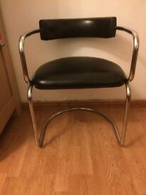 Chrome chair with black leather look seat