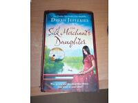 Signed copy of The Silk Mechants Daughter by Dinah Jeffries