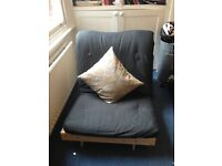 Single futon 195x80cm. Pinewood base, black cotton mattress. One year old.