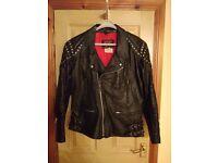 TT Leathers black leather motorcycle jacket.