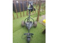 motorcaddy electric golf trolley with lithium battery and charger and brolly holder
