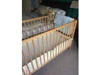 IKEA wooden cot, matching mattress, cot bumper and 2 sheets. In 'as new' condition