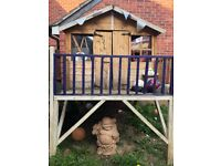 Wooden kids playhouse with slide